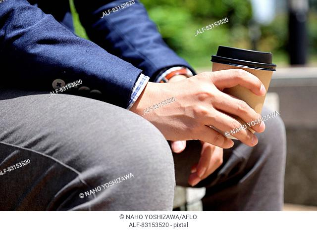 Japanese businessman with coffee
