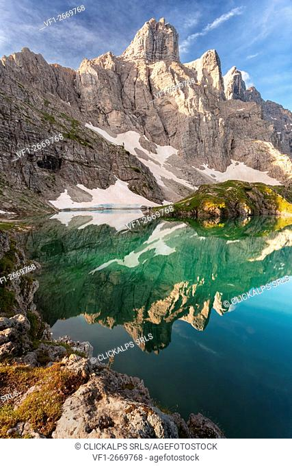 Europe, Italy, Veneto, Belluno. Lake of Coldai, the towers of mount Civetta are reflected in the water, Dolomites