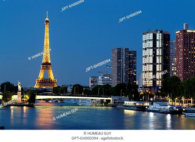VIEW OF THE MIRABEAU BRIDGE OVER THE SEINE BETWEEN THE EIFFEL TOWER, THE STATUE OF LIBERTY, THE GRENELLE BRIDGE AND THE BUILDINGS AND HIGHRISES ON THE BANKS OF...