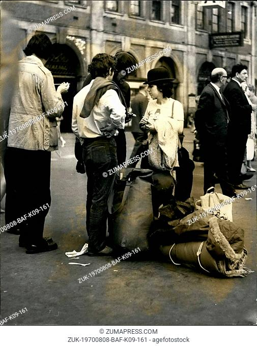 Aug. 08, 1970 - Fans leave Waterloo to attend the Isle of Wight pop festival photo shows This pop fan sports a bowler hat as she leaves Waterloo station for the...