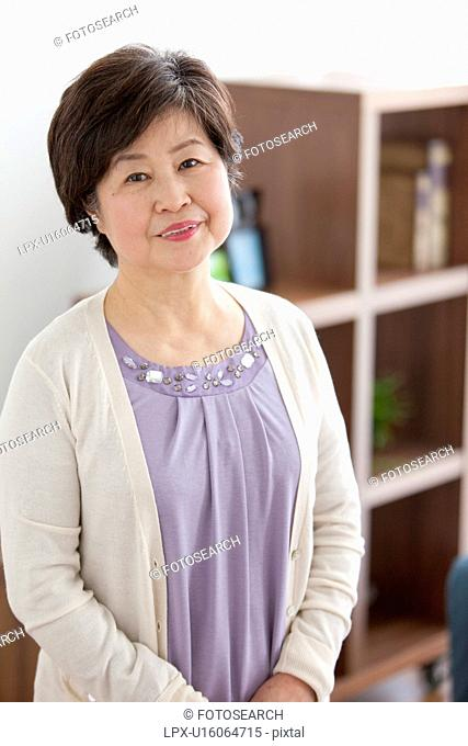 Mature Woman In Living Room