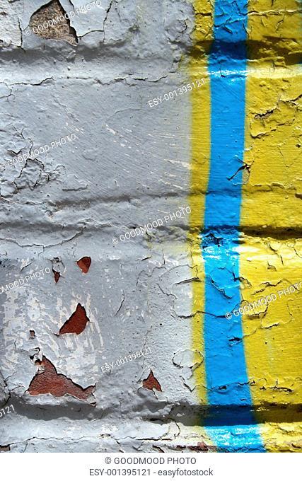 Graffiti detail on a peeling painted wall