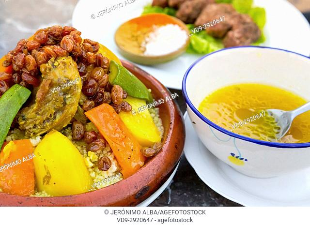 Typical Moroccan food, couscous with chicken and vegetable. Souk Medina of Fez, Fes el Bali. Morocco, Maghreb North Africa