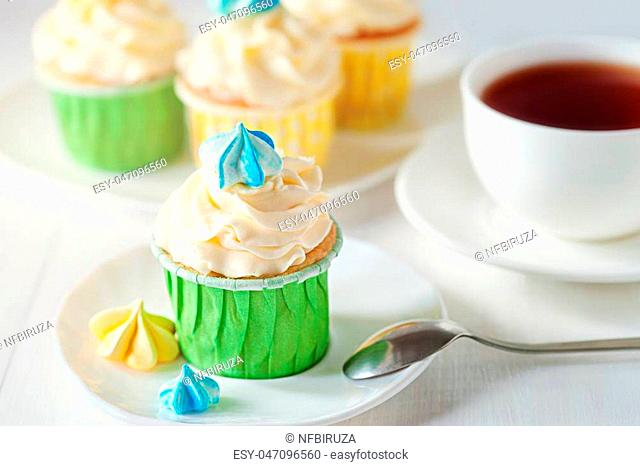 A sunny morning ladies breakfast tea with home cupcake with meringues. Good morning concept