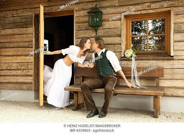 Wedding couple in front of an alpine mountain hut