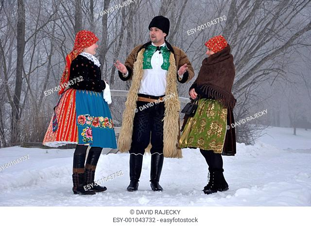 People in folk costume on christmas time