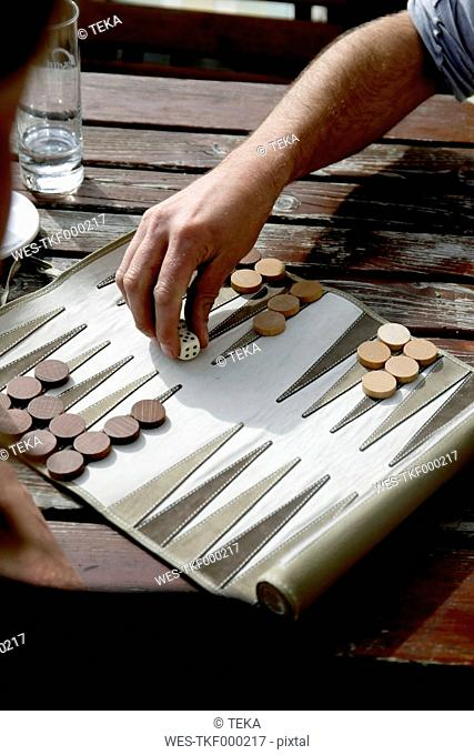 Austria, Tyrol, Men playing backgammon
