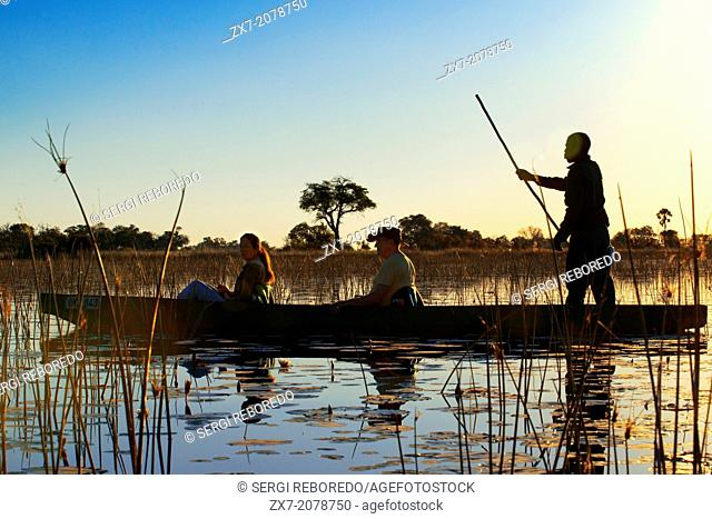 Water Safari canoe made †‹†‹calls mokoro starting from Camp Eagle Island Camp by Orient Express , outside the Moremi Game Reserve in Botswana