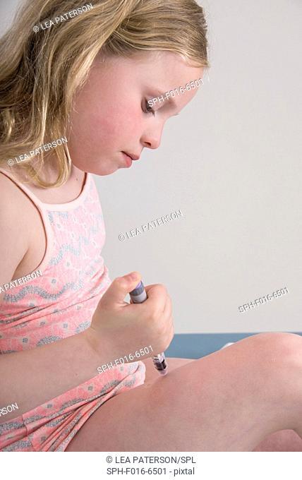 MODEL RELEASED. Girl injecting herself in leg
