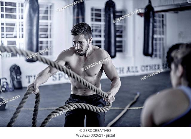 Man doing fitness training with ropes