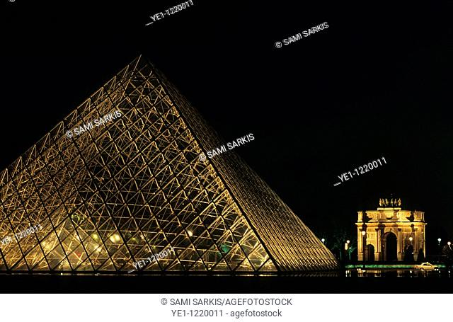 The Louvre Pyramid and the Arc de Triomphe du Carrousel at night, Paris, France