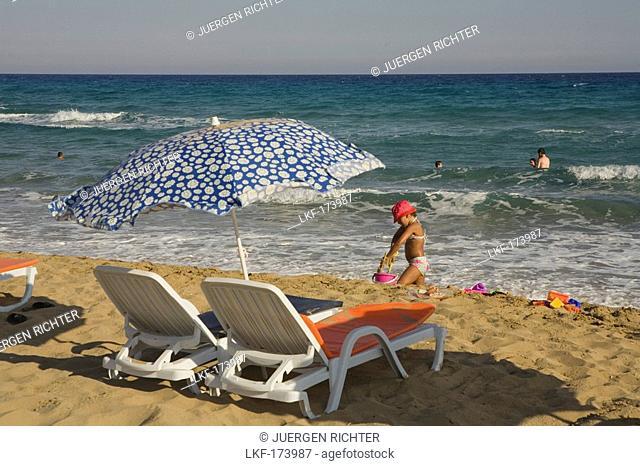 Girl playing on the beach, Golden Sands, Golden Beach, Dipkarpaz, Rizokarpaso, Karpasia, Karpass Peninsula, Cyprus
