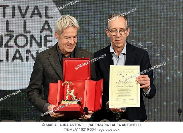 Claudio Baglioni receives the 'Amico di Sanremo ' Award (Friends of Sanremo) from the Mayor of Sanremo Alberto Biancheri during the final press conference of...