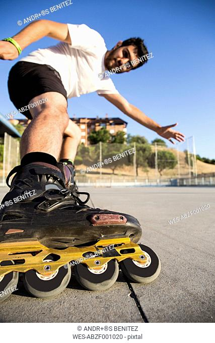 Man with rollerblades skating