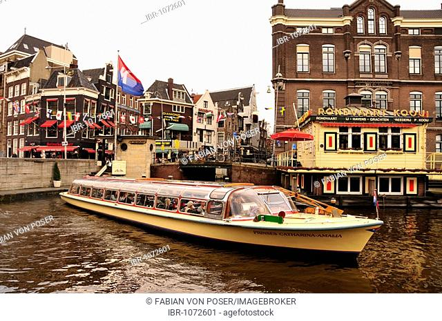 Boat in a canal in the city centre of Amsterdam, Holland, Netherlands, Europe