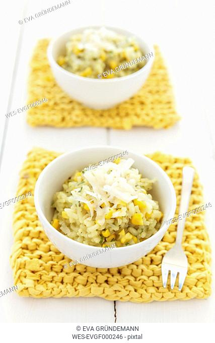 Two bowls of australian sweetcorn risotto, studio shot