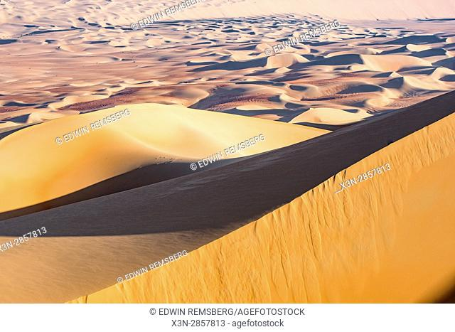 Liwa Oasis, Abu Dhabi , United Arab Emirates -i; vast number of sand dunes making desert landscape The Empty Quarter (Rub' al Khali) of the arabian peninsula is...
