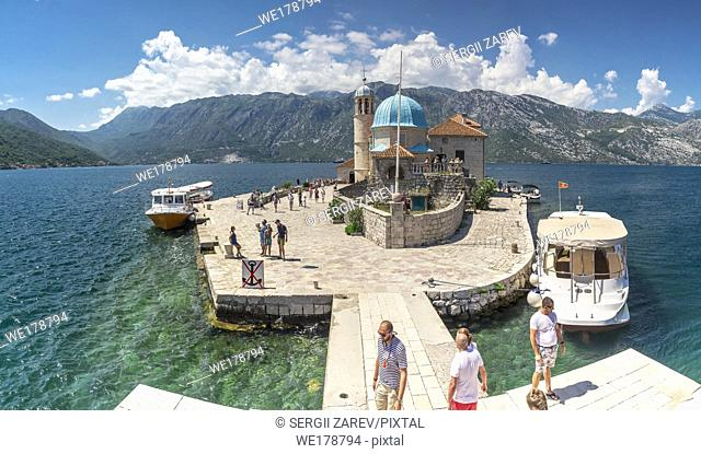 Perast, Montenegro - 07. 11. 2018. Our Lady of the Rocks church on an Island in the Bay of Kotor, Montenegro, in a sunny summer day