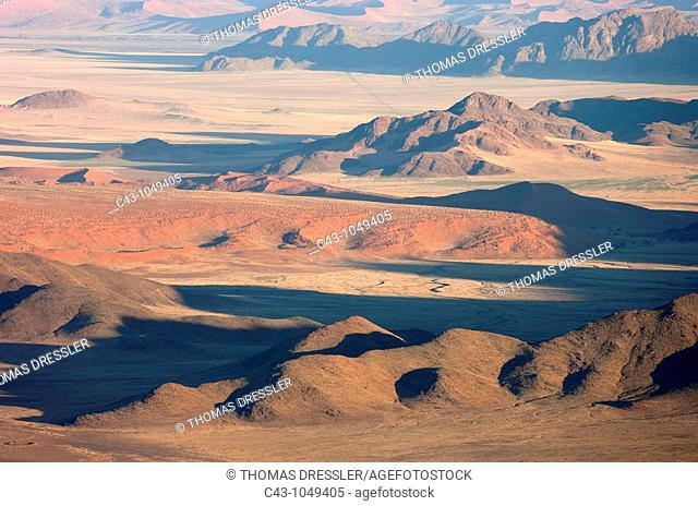 Namibia - Sand dunes and isolated mountain ridges at the edge of the Namib Desert  Aerial view from a hot-air balloon  NamibRand Nature Reserve, Namibia