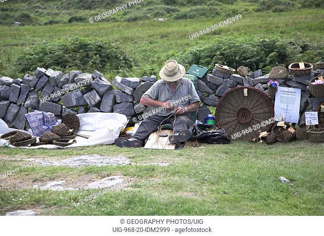 Craftsman making wicker goods Inishmore Aran Islands, County Clare, Ireland