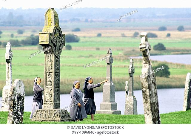 Roman Catholic nuns visit Clonmacnoise Monastery on the River Shannon, County Offaly, Ireland  Founded AD 547 by Saint Ciaran