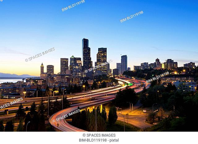 Freeways and Seattle skyline at sunset, Seattle, Washington, United States