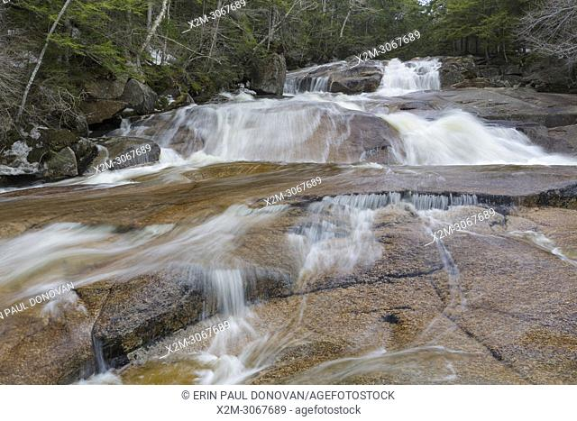 One of the many cascades on Cascade Brook in Lincoln, New Hampshire on a spring day. This brook is located along the Basin-Cascades Trail