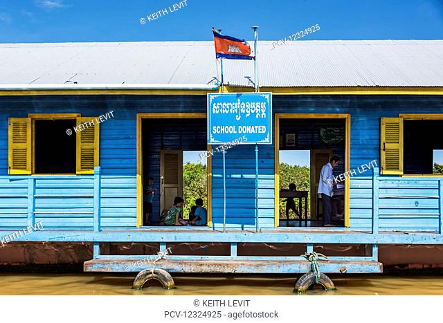A blue house in a floating village on Tonle Sap; Kampong Phluk, Siem Reap Province, Cambodia