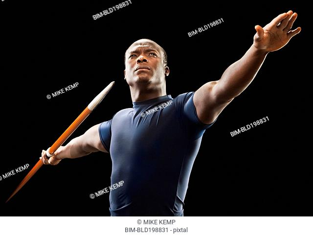 African American man holding track and field javelin