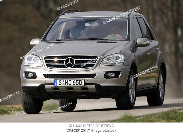 Mercedes ML 350, model year 2005-, silver, driving, diagonal from the front, frontal view, country road