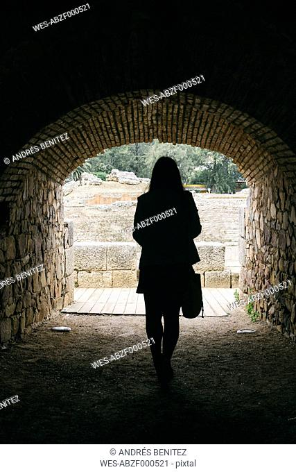 Spain, Merida, back view of woman in a tunnel