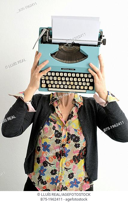 Woman with typewriter covering her face