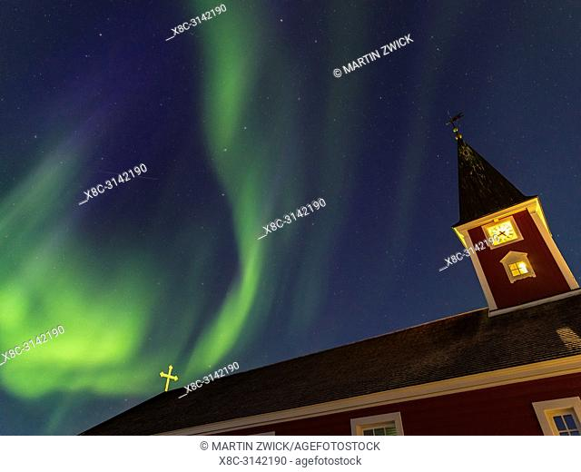 Northern lights over the Church of our saviour, the cathedral of Nuuk. The old town of Nuuk, the capital of Greenland. America, North America, Greenland