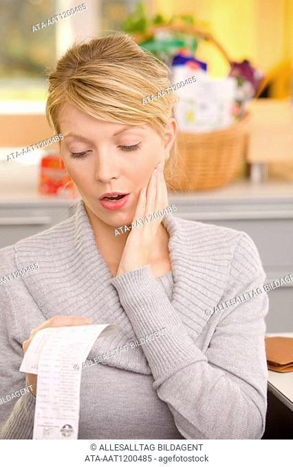 Woman checking receipts