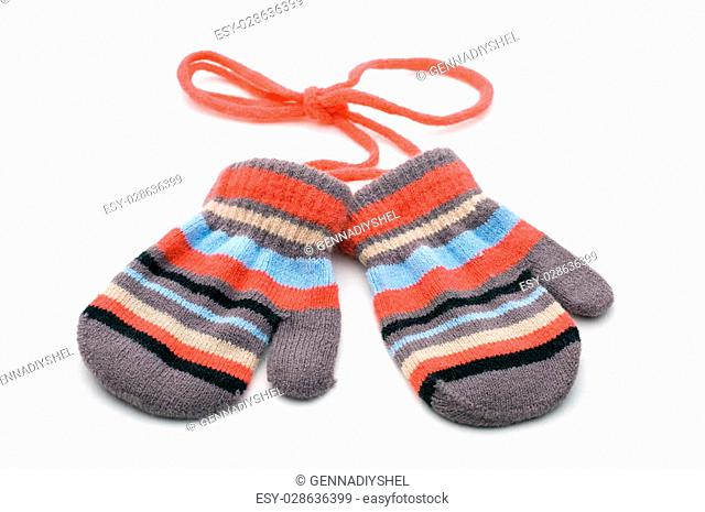 two knitted striped baby mittens isolated on white background