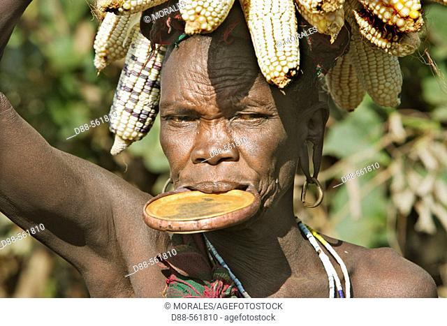 Surma woman carrying corn. Near Kibish. Ethiopia