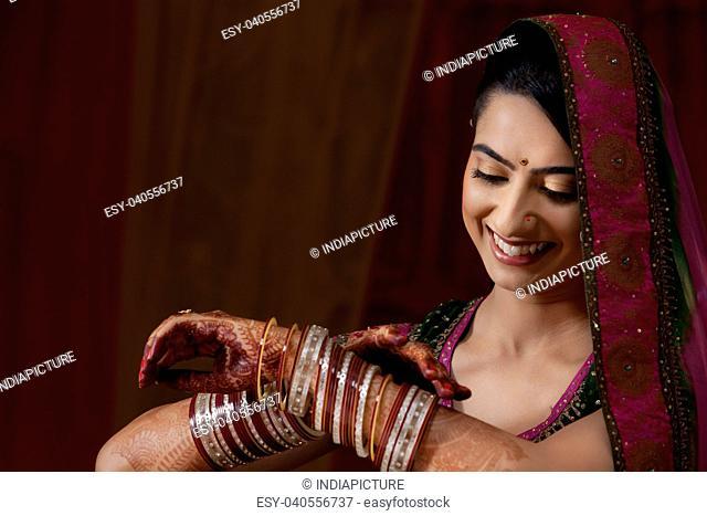 Indian bride admiring her bangles