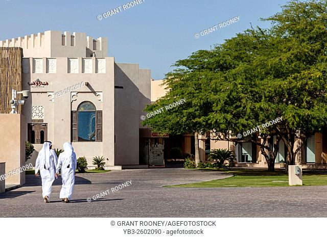Local Men In Traditional Clothes At The Katara Cultural Village, Doha, Qatar