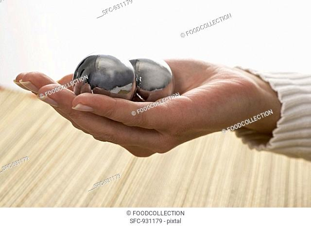Qi Gong balls in a woman's hand