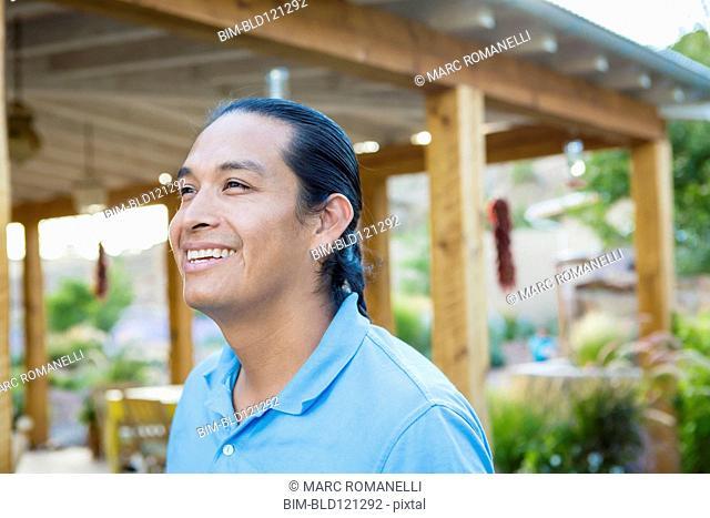 Man smiling outdoors