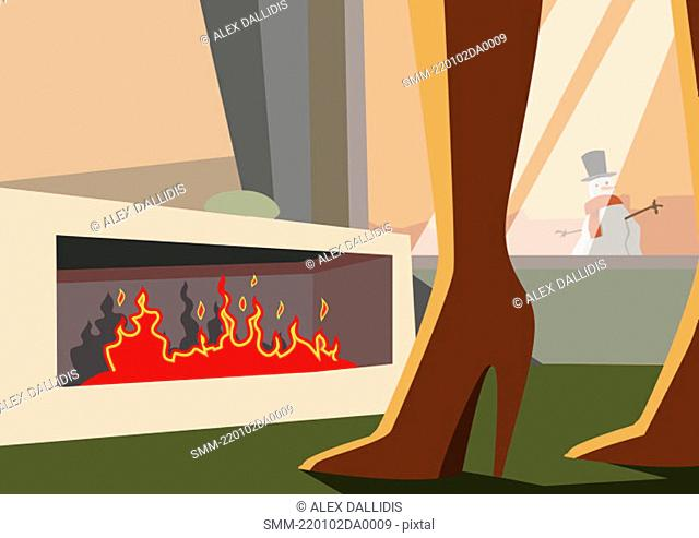 Woman's legs by the fireplace