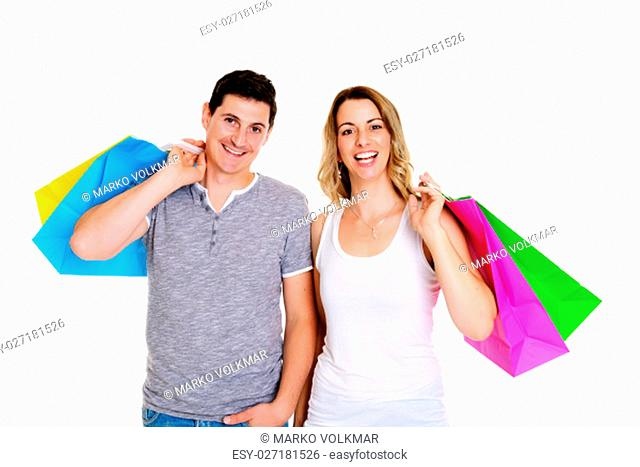 happy young couple with shopping bags in front of white background
