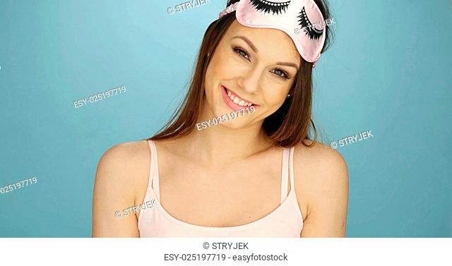 Pretty young woman with a sleep mask