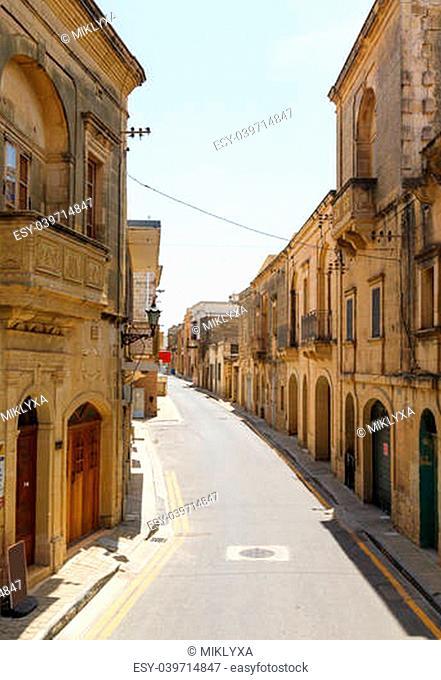 Traditional narrow street in Malta. Maltese architecture in Valletta, Malta