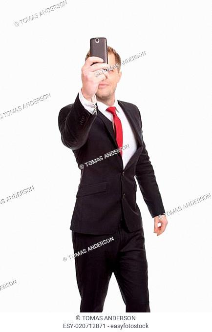 Handsome businessman taking a selfie