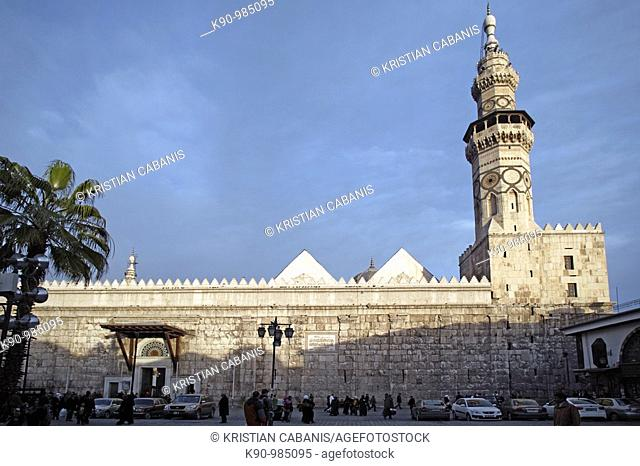 View from the market place to the Omayyaden Mosque with its impressive wall and tall minaret during a sunny day with blue, clear sky, Damascus, Syria