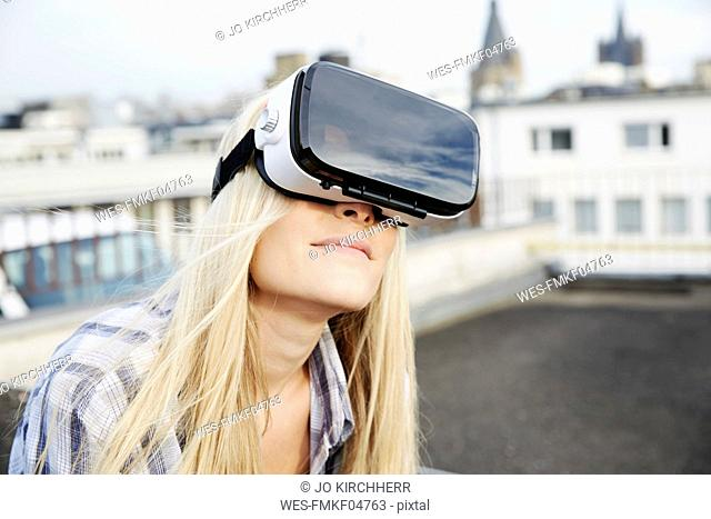 Portrait of woman wearing Virtual Reality Glasses outdoors