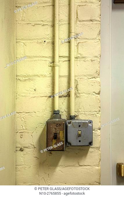 Old light switches on a brick wall