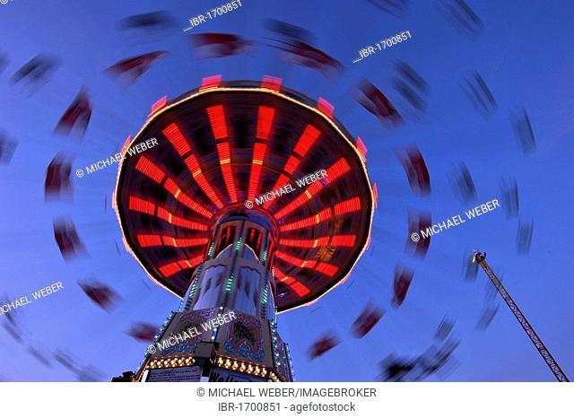 Chair-o-planes or swing carousel at dusk, Cannstatter Wasen or Volksfest, Stuttgart Beer Festival, Wasen, Bad Cannstatt, Stuttgart, Baden-Wuerttemberg, Germany