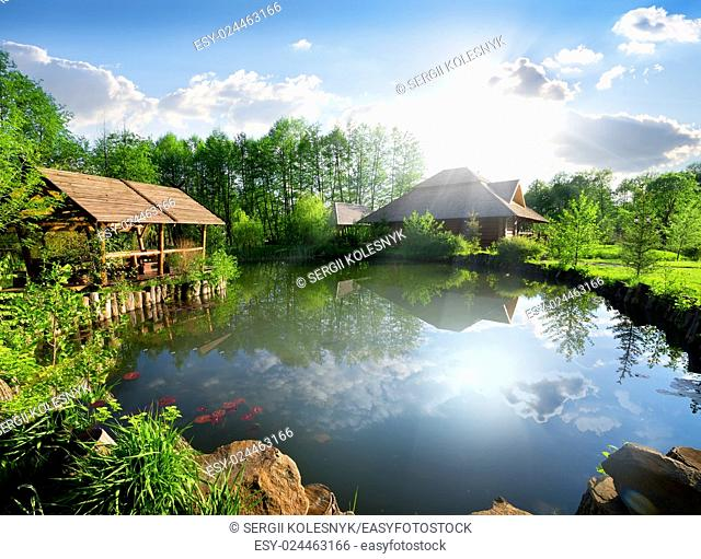 Wooden cottage near lake at sunny day
